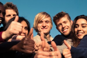 Group of People in their 20s with thumbs up