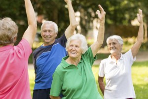 Group of people in their 70s exercising
