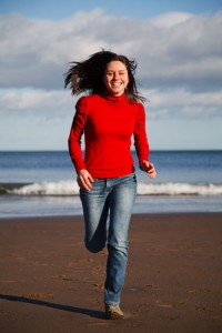 Woman running on beach energy boost