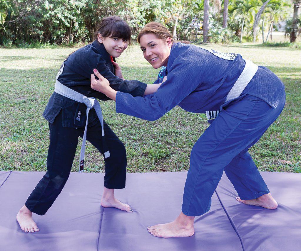 Gesenia with her daughter doing jiujitsu. .