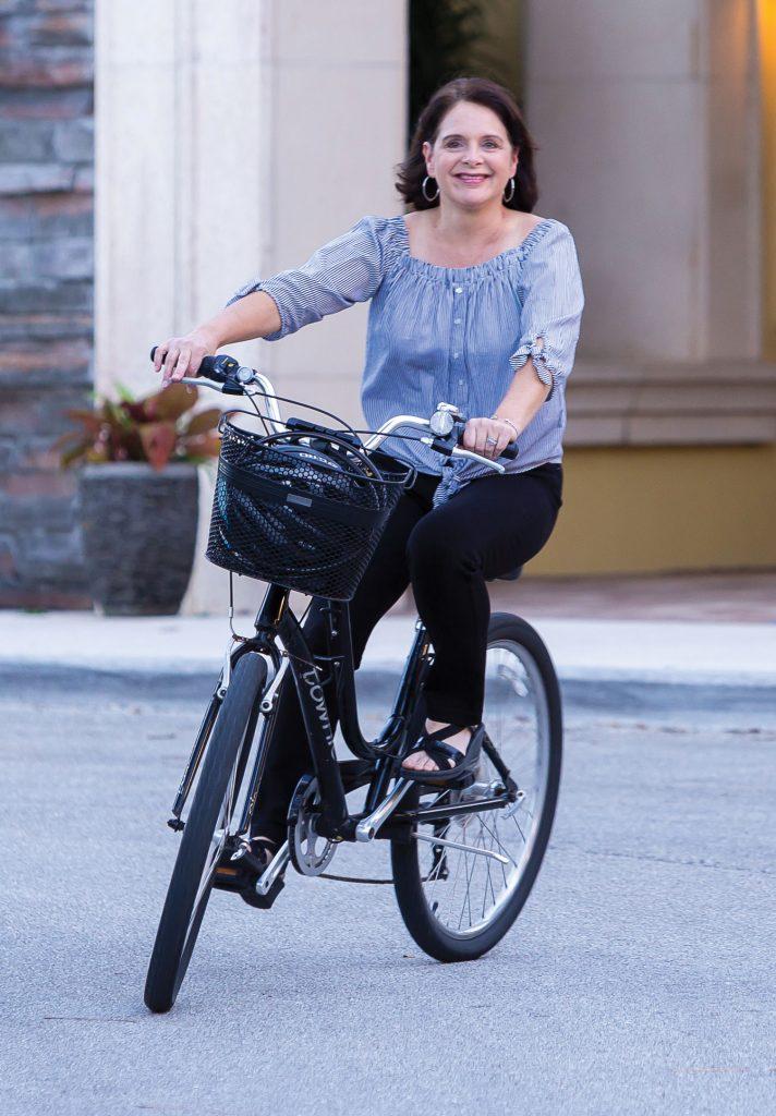Rebecca Ramirez riding her bike.