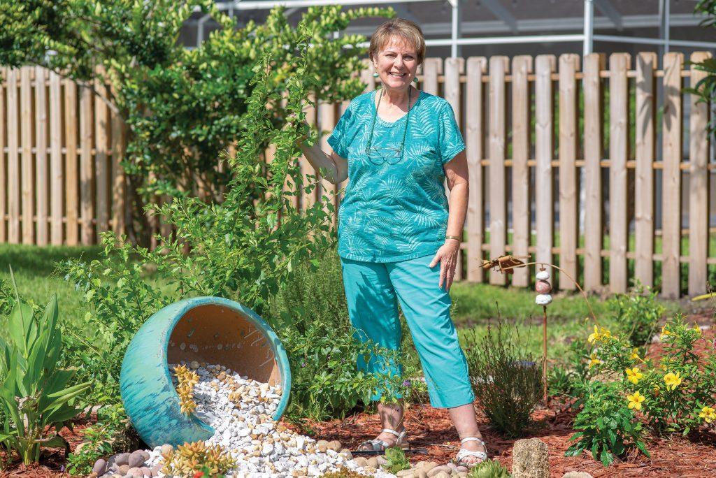 Gail standing in her garden.