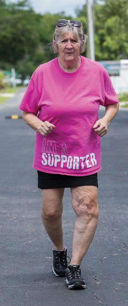 Linda Burr running down a road