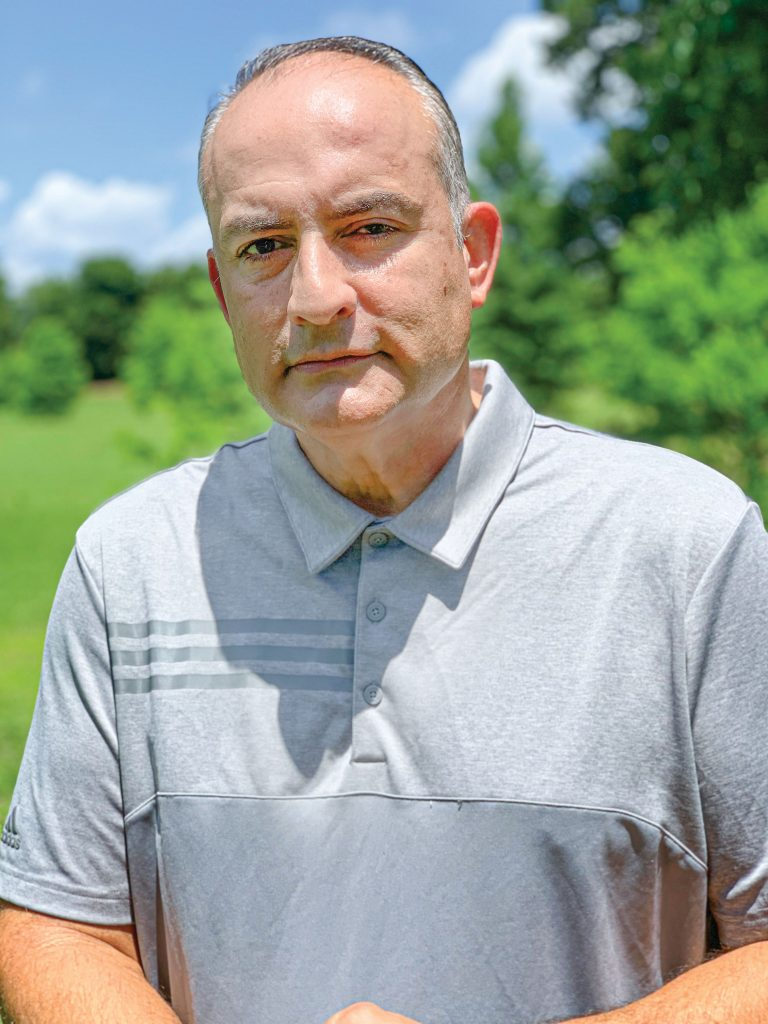 Headshot of Larry Gonzalez on a golf course