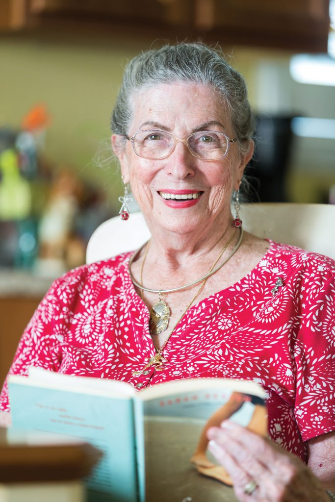 Annette Nichols reading a book